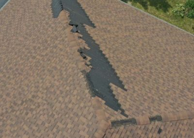 Zippered Roof Shingles From Wind Damage